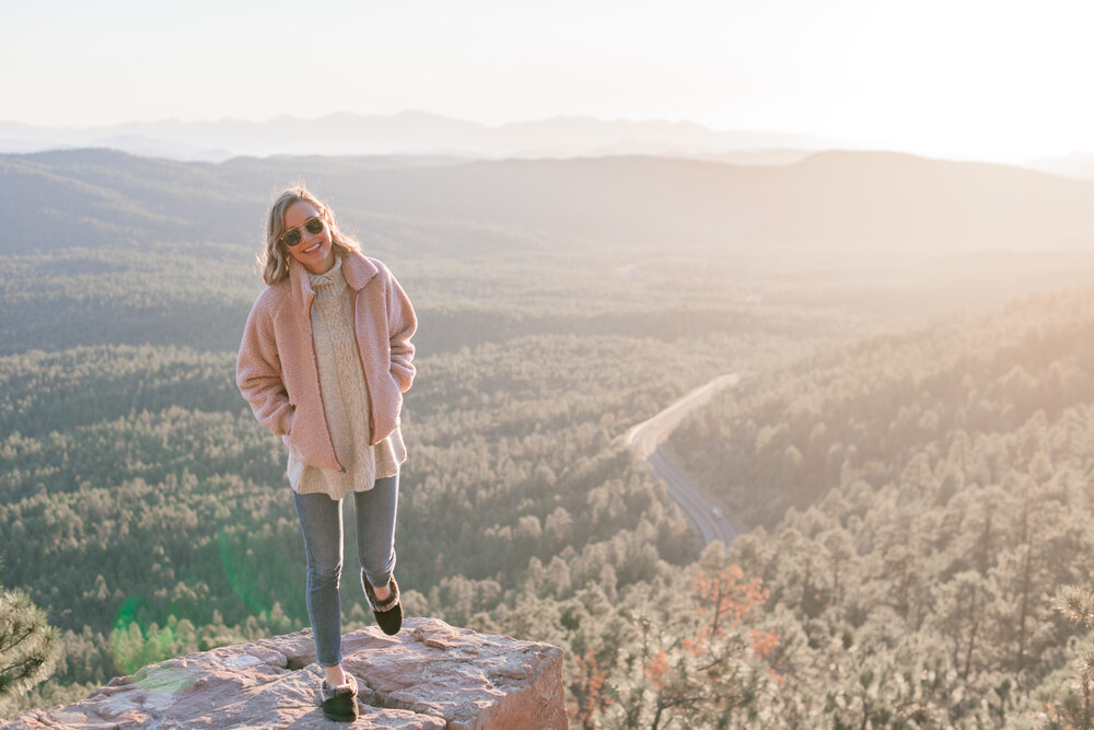20 fun fall bucket list ideas for couples by top US lifestyle blog, Love + Specs: image of a woman watching the sunset in Arizona