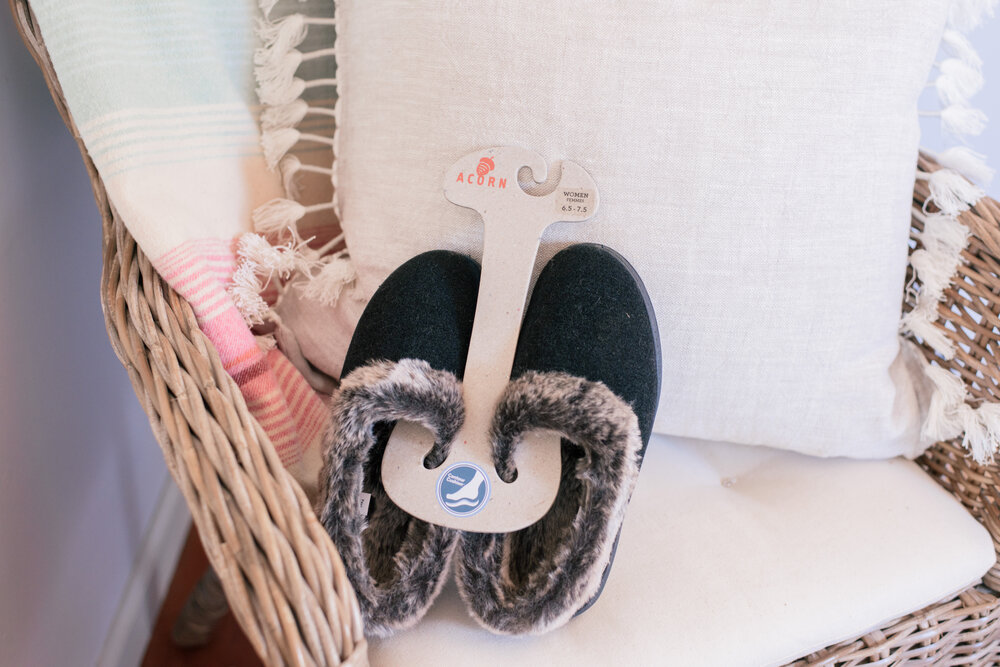 The best fun fall activity ideas for families by top US lifestyle blog, Love and Specs: image of Acorn slippers on chair