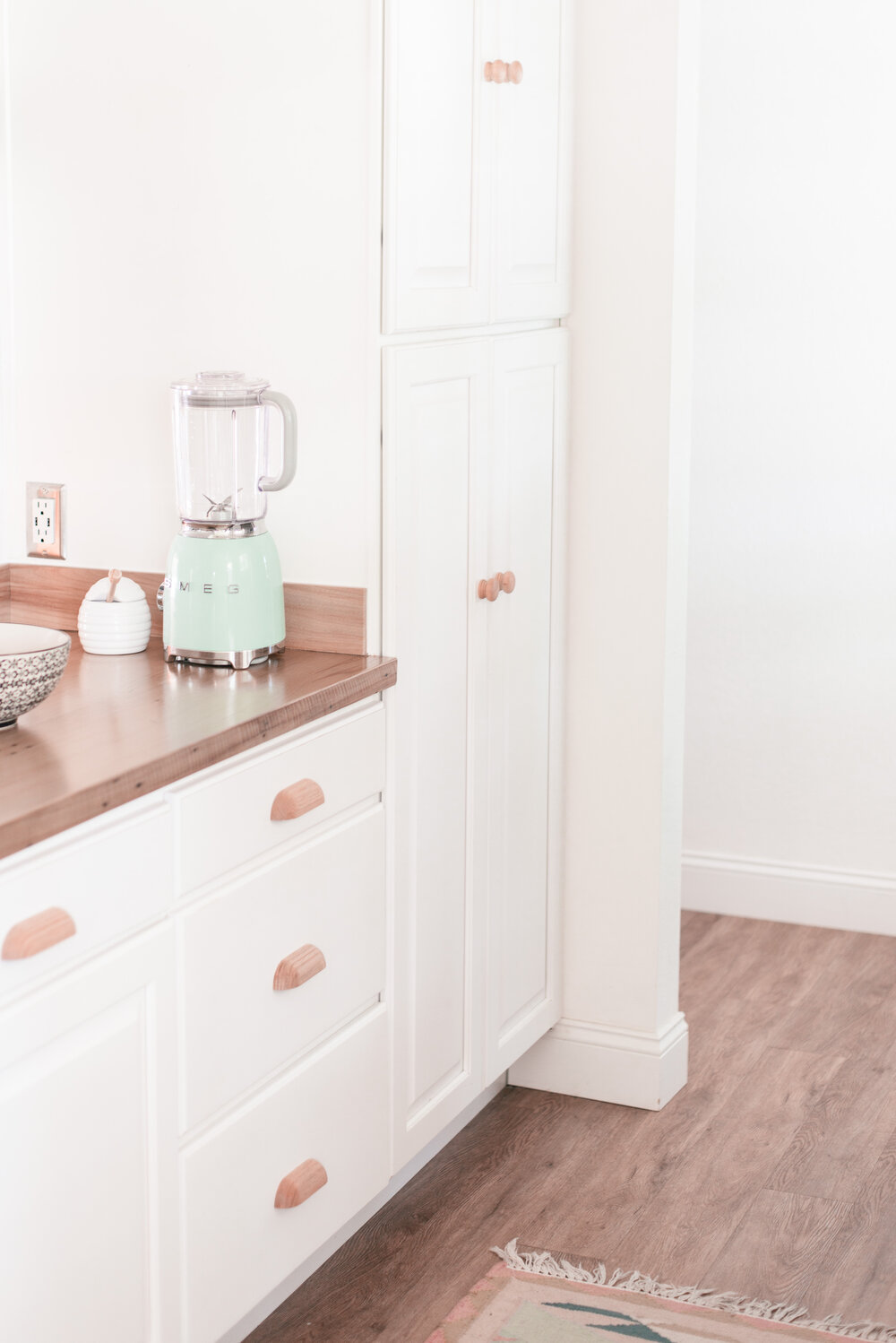 Easy DIY Wood Kitchen Cabinet Hardware Makeover featured by top US home decor blog, Love & Specs