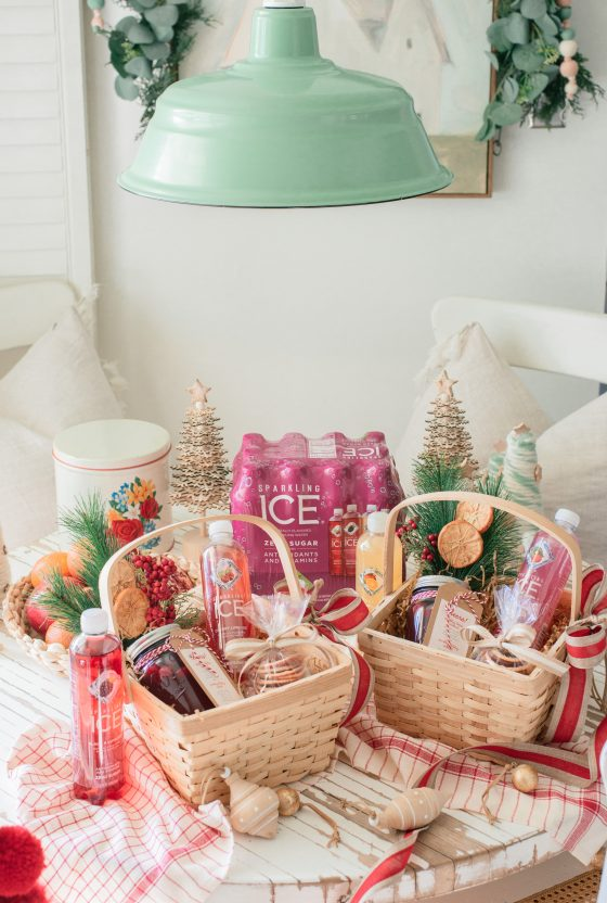 Sparkling Ice Drinks by popular Phoenix lifestyle blog, Love and Specs: image of two gift baskets filled with Sparkling Ice drinks, cookies, drink mix in a mason jar, and pine sprigs with dried oranges.