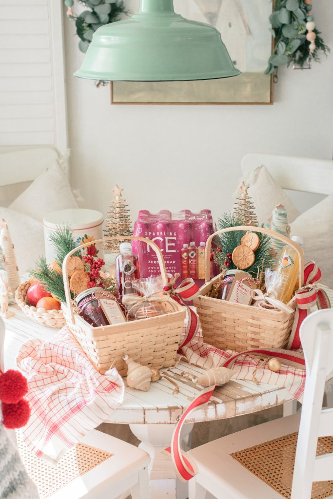 Sparkling Ice Drinks by popular Phoenix lifestyle blog, Love and Specs: image of gift baskets filled with Sparkling Ice drinks, cookies, drink mix in a mason jar, and pine sprigs with dried oranges.