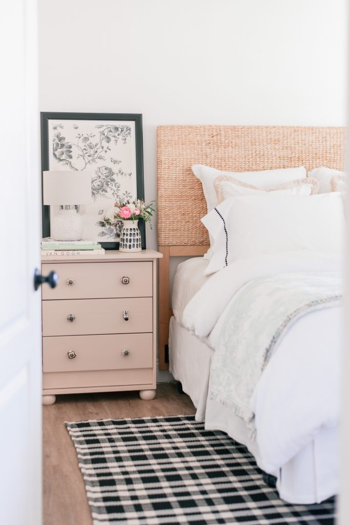 Cottage Style by popular Phoenix life and style blog, Love and Specs: image of a bed with a woven grass headboard and white beddign next to a peach colored dresser.